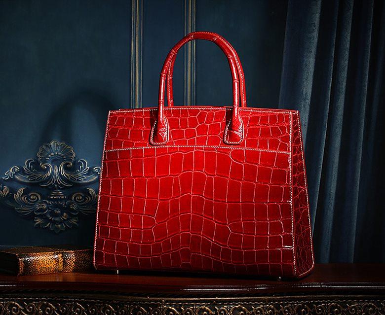 Red alligator leather handbag